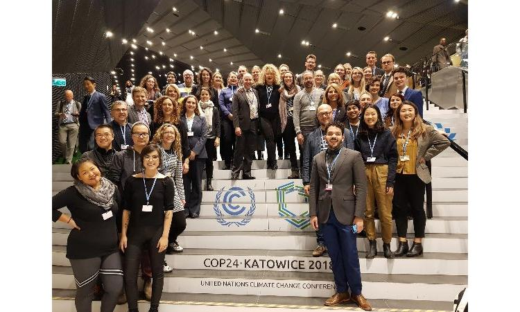 COP24 Delegates on staircase