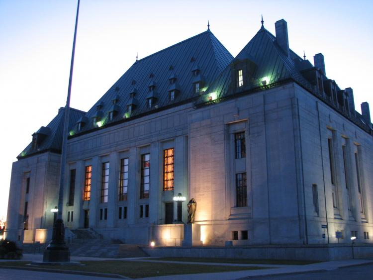 Photo of Supreme Court of Canada building in early evening